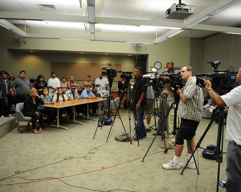 Description of . News media attend  a press conference at the San Bernardino County Sheriff's Headquarters Thursday August 22, 2013 in San Bernardino for Daniel Olivera 26, of Hesperia who was shot and killed at the AM/PM Arco convenience store on August 11, 2013 in Victorville.LaFonzo Carter/Staff Photograph