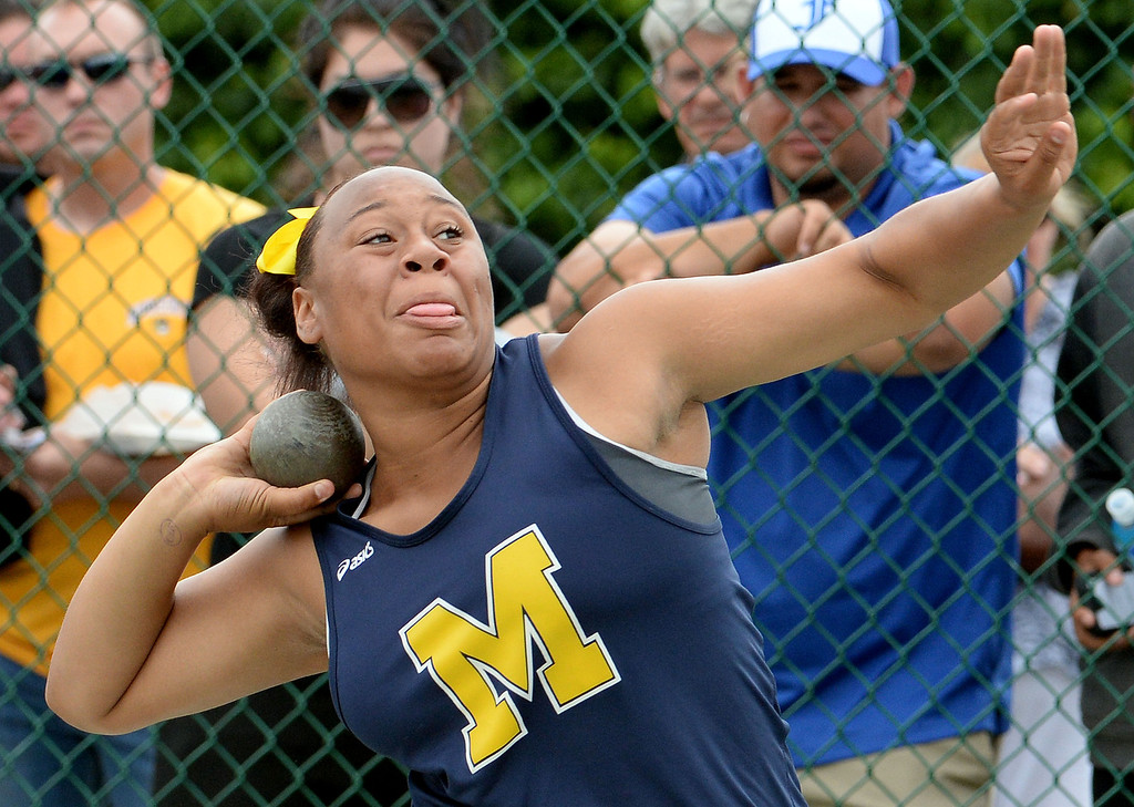 Description of . Muir's Tierra Adams competes in the division 4 shot put during the CIF Southern Section track and final Championships at Cerritos College in Norwalk, Calif., on Saturday, May 24, 2014. 