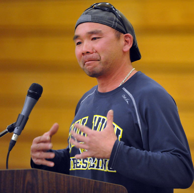 Description of . Wrestling Coach Doug Loo, speaks about Tim Keeler, a teacher, coach and videographer and photographer, during his memorial event at California High School gym in Whittier on Friday April 4, 2014. Students and friends wrote their notes and memories on a larger poster that said
