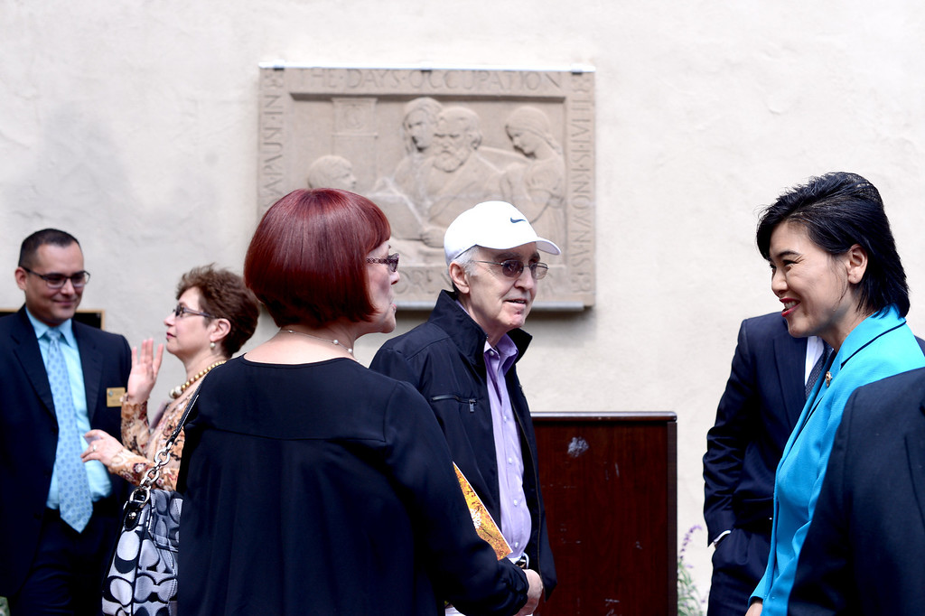 "Description of . Congresswoman Judy Chu, far right, speaks with JIm and Yolanda Giallo, of San Marino, after she and South Pasadena Mayor Marina Khubesrian unveiled Merrell Gage's recently restored 1930 bas relief masterpiece, ""The Children's Hour"" at South Pasadena Public Library Friday, March 21, 2014. The 600 lb. stone casting survived fire, breakage, and being buried until it was deemed to possess great local and national significance. (Photo by Sarah Reingewirtz/Pasadena Star-News)"