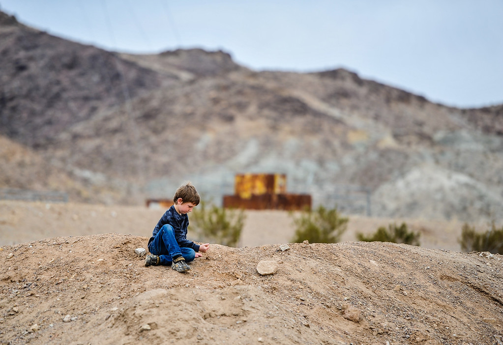 Description of . Aiden Banks, 6, plays in the yard of his family's 10-acre land parcel in Hinkley, Calif. on Thursday, March 7, 2013. Aiden is a third generation Hinkley resident. Seventeen years after Erin Brockovich and the movie she inspired was released,the future of the small High Desert town of Hinkley is at stake. In the last two years, residents have become aware that a toxic water plume continues to grow below their small town. (Rachel Luna / San Bernardino Sun)