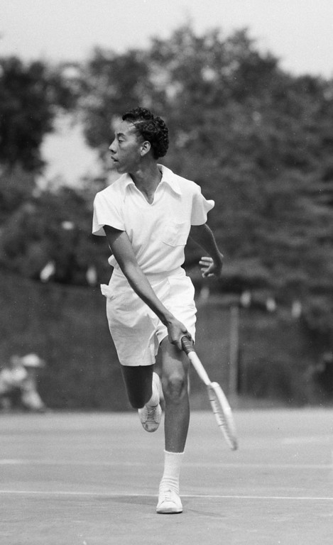 Description of . Tennis player Althea Gibson of Tallahassee, Fla., completes a return in her first round of play against Mela Ramirez, the Mexican women\'s champ, July 18, 1950 in River Forest, Ill.  Ms. Gibson won, 6-3 and 6-1.  (AP Photo)