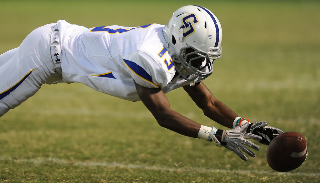Description of . Charter Oak's Dareon Nash (13) misses a catch against Bishop Amat  in the first half of a prep football game at Bishop Amat High School in La Puente, Calif. on Friday, Sept. 20, 2013.    (Photo by Keith Birmingham/Pasadena Star-News)