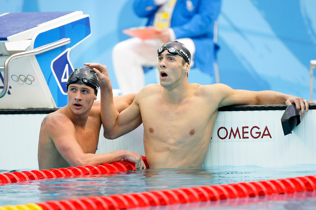 Description of . United States\' Michael Phelps, right, with teammate Ryan Lochte after Phelps won the men\'s 200-meter individual medley final during the swimming competitions in the National Aquatics Center at the Beijing 2008 Olympics in Beijing, Friday, Aug. 15, 2008. (AP Photo/Itsuo Inouye)
