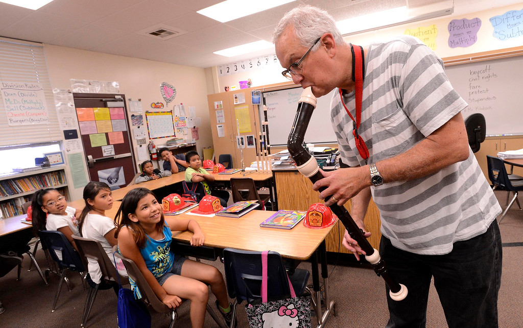 Description of . Musician Kim Hutchcroft plays a wood instrument during a presentation to third graders about his career during the final day of the 19th Annual Career Awareness Week at Lankershim Elementary School in Highland June 6, 2013.  GABRIEL LUIS ACOSTA/STAFF PHOTOGRAPHER.