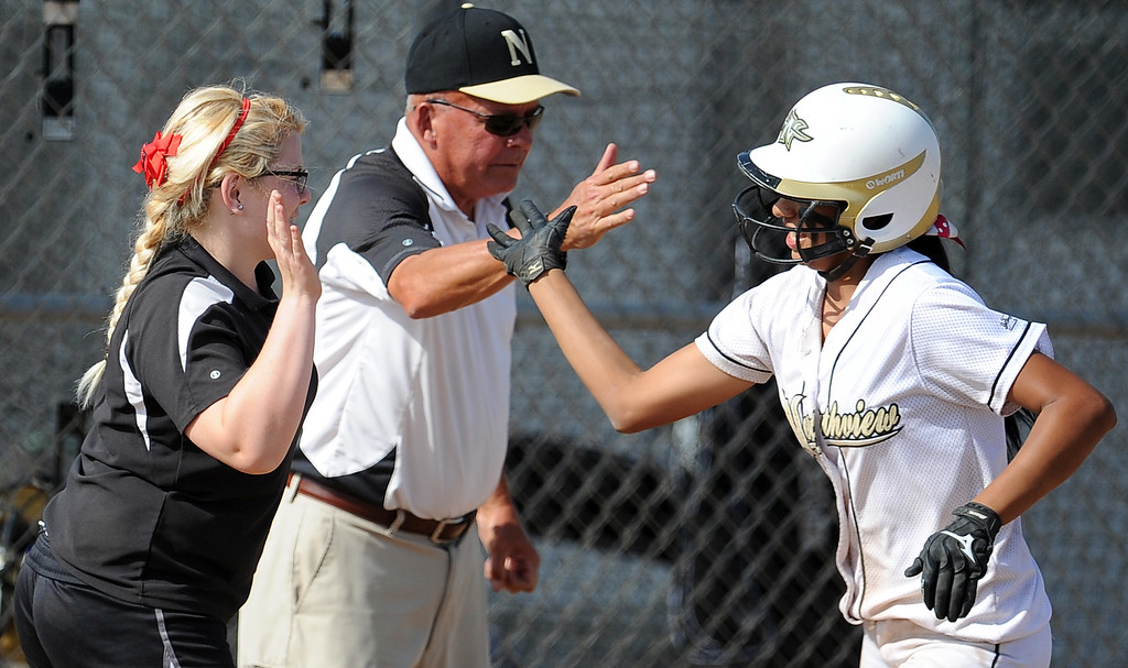 Description of . Northview's Jocelyn Marquez high fives Northview's Jeffrey Butler, center, and an unidentified coach after hitting a solo home run in the sixth inning of a CIF-SS quarterfinal playoff softball game against Barstow at Northview High School on Thursday, May 23, 2013 in Covina, Calif. Northview won 5-4.  (Keith Birmingham Pasadena Star-News)