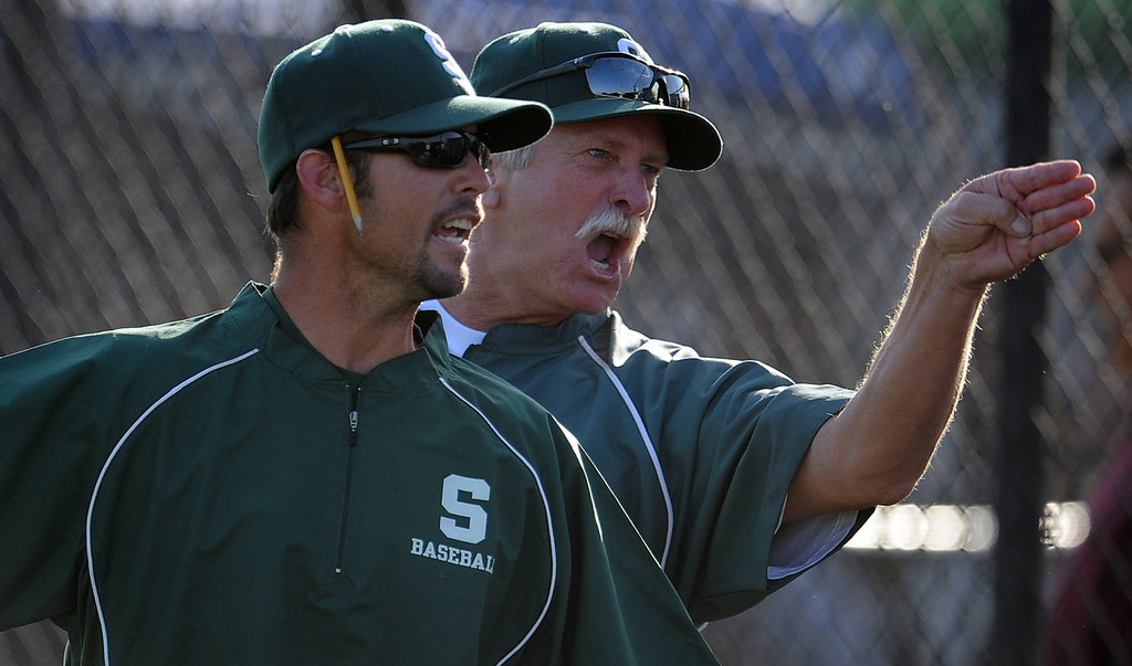 Description of . South (Torrance) head coach Grady Sain, left, and a unidentified coach yells at the home plate umpire (not pictured) after Northview won 5-4 during a CIF-SS prep second round playoff baseball game at Northview High School on Tuesday, May 21, 2013 in Covina, Calif. 