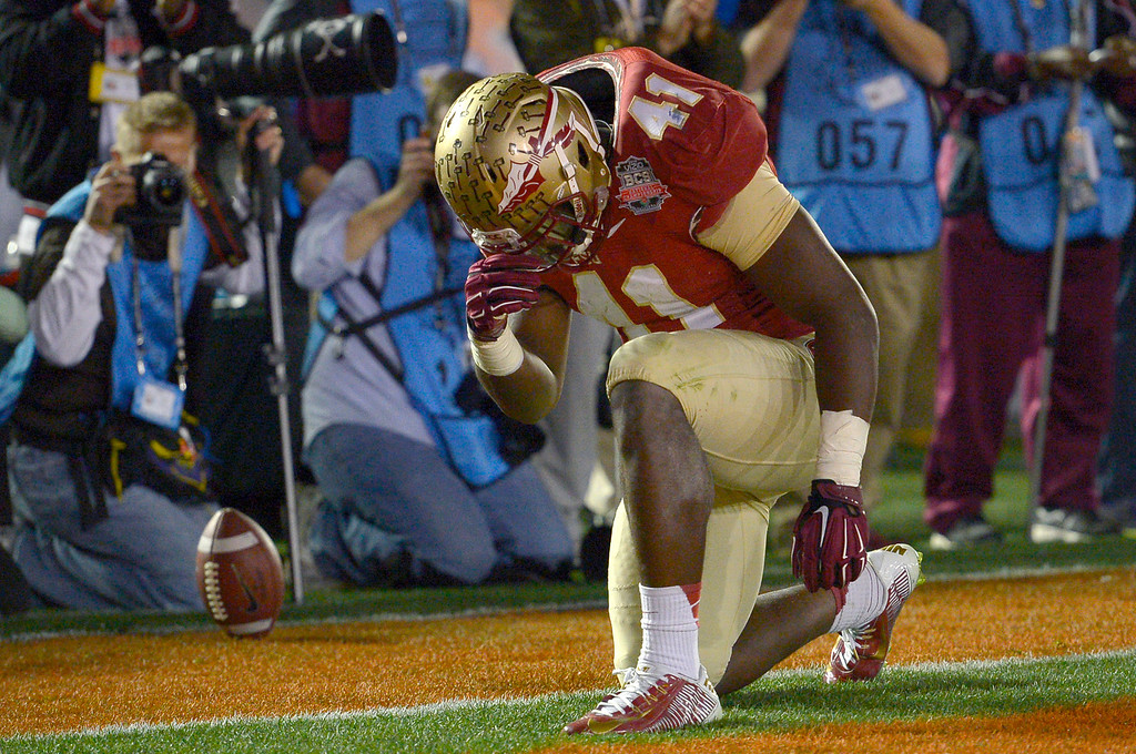 Description of . Florida State's Chad Abram reacts after scoring a fourth quarter touchdown against Auburn during the 2014 Vizio BCS National Championship January 6, 2014 in Pasadena CA.  Florida State won the game 34-31.(Andy Holzman/Los Angeles Daily News)