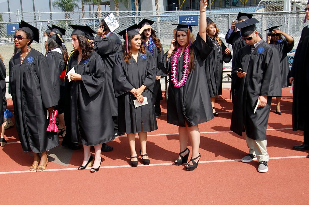 Description of . Graduates during the Citrus College 97th Commencement Ceremony, at Citrus College Stadium, in Glendora, Saturday, June 15, 2013. (Correspondent Photo by James Carbone/SVCITY)