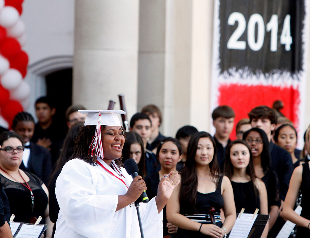Description of . Redlands East Valley High School graduate Savannah Edwards sings the national anthem during the class of 2014 graduation ceremony on Thursday, June 12, 2014 at the Redlands Bowl in Redlands, Ca.  (Photo by Micah Escamilla/Redlands Daily Facts)
