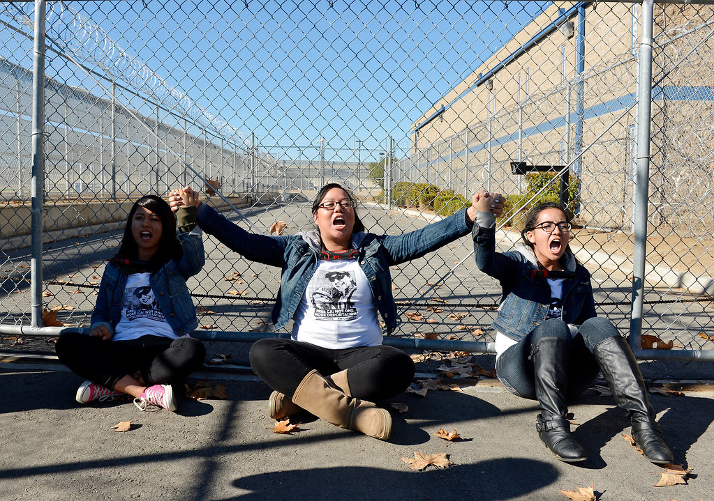 Description of . Over 100 protesters took part in a peaceful rally Monday November 25, 2013 at the privately owned Adelanto Detention Facility in Adelanto, Calif. The protesters, with the Inland Empire Immigrant Coalition, were protesting  to demand the release of three prisoners on ICE holds who they say shouldn't be incarcerated because they're infractions were minor and they've been in too long already. It comes in the wake of highly critical report recently released by the nonprofit Detention Watch Network, detailing alleged abuses and civil rights violations of prisoners at the Adelanto facility and nine similar institutions nationwide.(Will Lester/Inland Valley Daily Bulletin)
