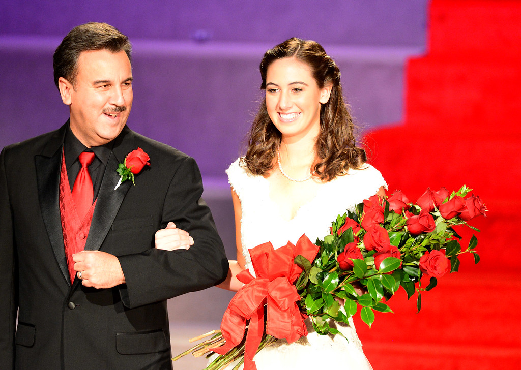 Description of . Ana Acosta is escorted by her father John before being crowned the 96th Rose Queen during the Tournament of Roses' coronation ceremony Thursday night, October 24, 2013 at the First Church of the Nazarene of Pasadena. (Photo by Sarah Reingewirtz/Pasadena Star-News)