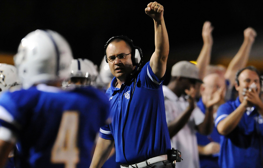 Description of . Charter Oak coach Dominic Farrar reacts after Donavin Washington (4) runs for a touchdown against Damien in the first half of a prep football game at Charter Oak High School in Covina, Calif., Friday, Oct. 11, 2013.    (Keith Birmingham Pasadena Star-News)