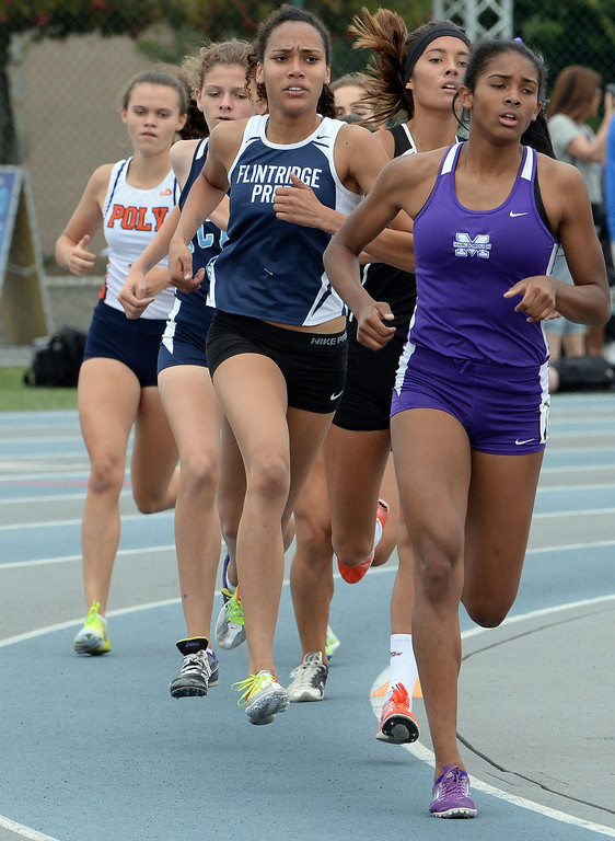 Description of . Flintridge Prep's Sarah Yoho competes in the division 4 1600 meter race during the CIF Southern Section track and final Championships at Cerritos College in Norwalk, Calif., on Saturday, May 24, 2014. 