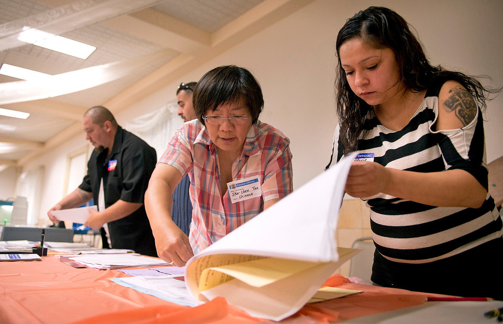 Description of . Poll workers prepare for voters at the Greenleaf Masonic Temple on Beverly Boulevard in Whittier, Calif. Tuesday morning June 3, 2014.   (Staff photo by Leo Jarzomb/Whittier Daily News)