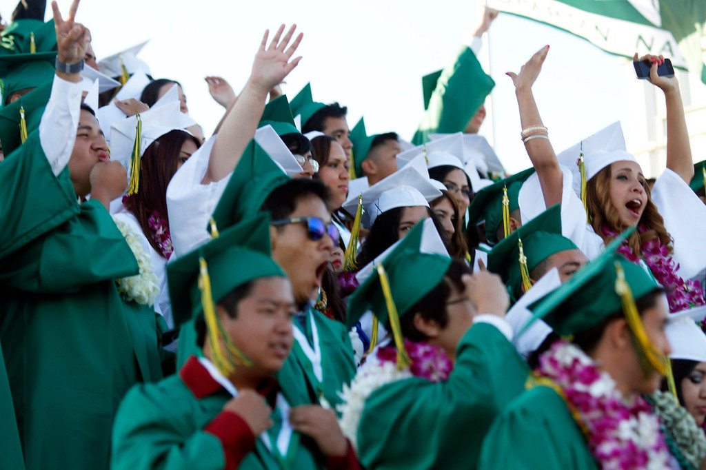 Description of . Jubilant Graduates during Schurr High School 2013 Commencement Exercises, at Ken Davis Field, at Schurr High School in Montebello, Thursday, June 20, 2013. (Correspondent Photo by James Carbone/SWCITY)