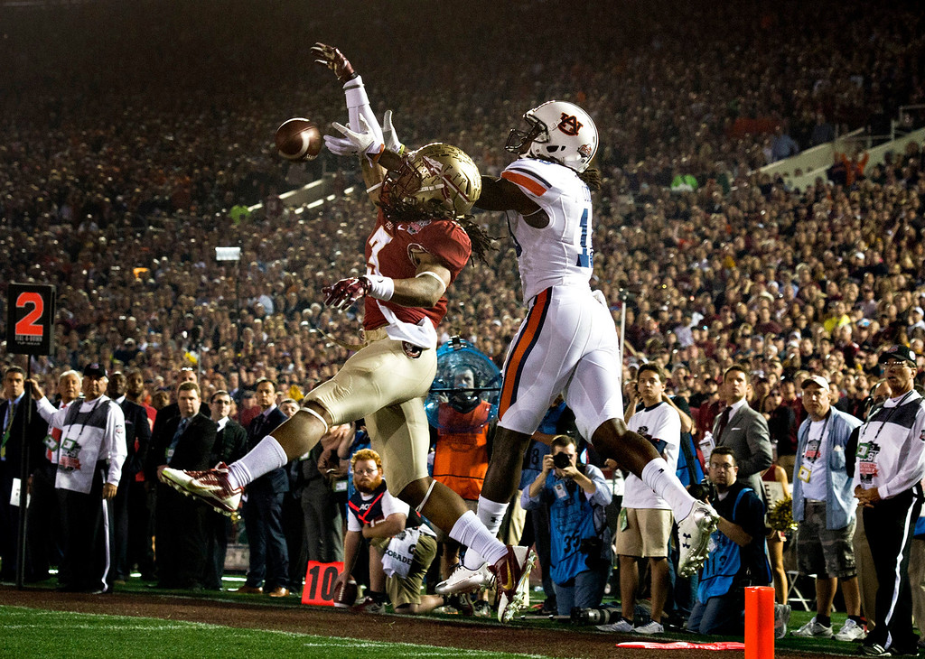Description of . Wide receiver Jesus Wilson (3) of Florida State goes up for an incomplete over Chris Davis (11) of Auburn in the first half during the BCS National Championship game at the Rose Bowl in Pasadena Calif. on Monday, Jan. 6, 2014. (Watchara Phomicinda/ Pasadena Star-News)
