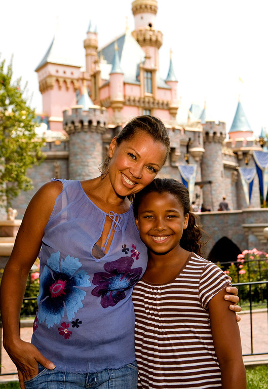 Description of . In this image released by Disneyland, actress Vanessa Williams and her daughter Sasha, 8, pose in front of Sleeping Beauty's Castle at Disneyland in Anaheim, Calif., on Tuesday, June 24, 2008.  (AP Photo/Disneyland, Paul Hiffmeyer)