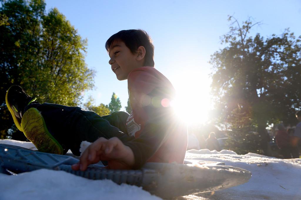 Description of . Children go sledding during Montebello's annual Winter Wonderland at Montebello City Park Saturday, December 14, 2013. (Photo by Sarah Reingewirtz/Pasadena Star-News)