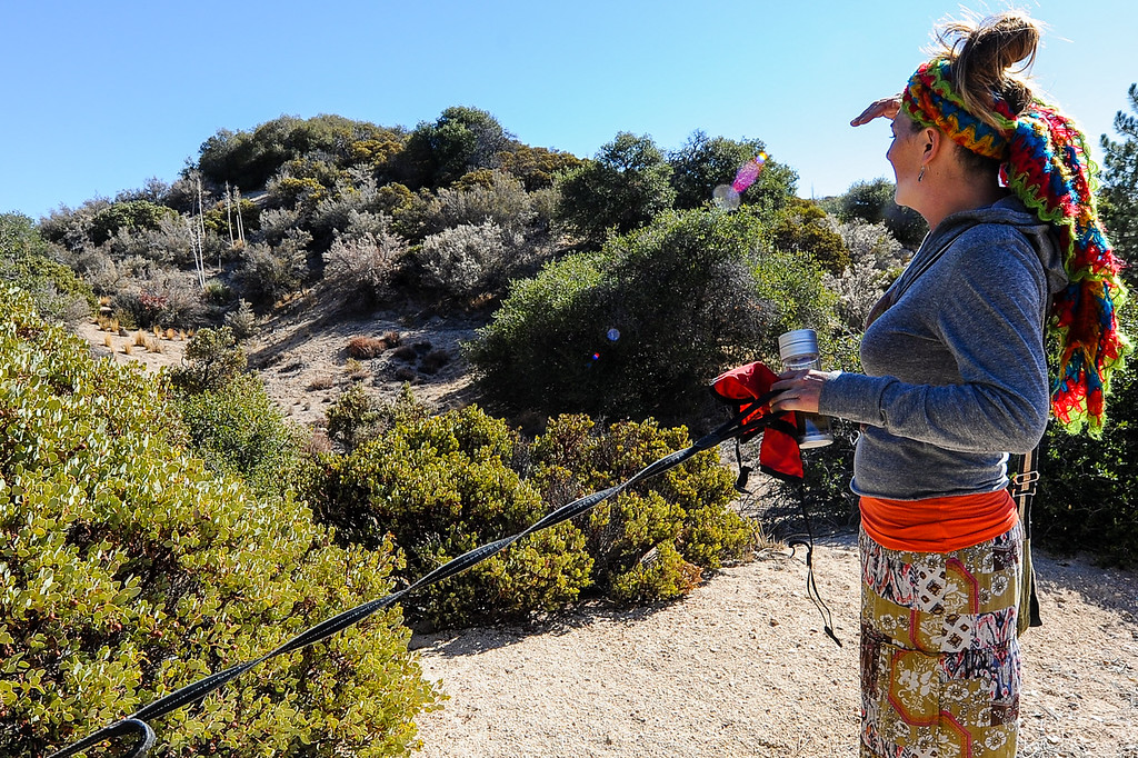 Description of . Search and rescue volunteer Lynne Lomerick, of Deer Lodge Park, searches along the Pinnacle Trail for a missing German hiker in the San Bernardino Mountains near Lake Arrowhead on Friday, Oct. 4, 2013. (Photo by Rachel Luna / San Bernardino Sun)