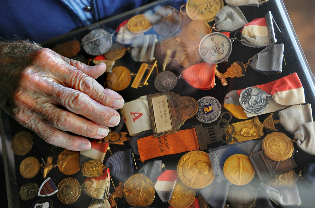 Description of . Louis Zamperini, 94, at his Hollywood home with various track medals from his early running matches.  (Photo by Brad Graverson/Daily Breeze) 11-7-10