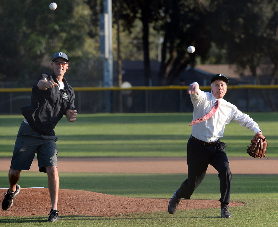 Description of . Cereimonial first pitch prior to a prep baseball game between San Dimas and Bonita at Bonita High School in La Verne, Calif., on Wednesday, March 19, 2014.  (Keith Birmingham Pasadena Star-News)
