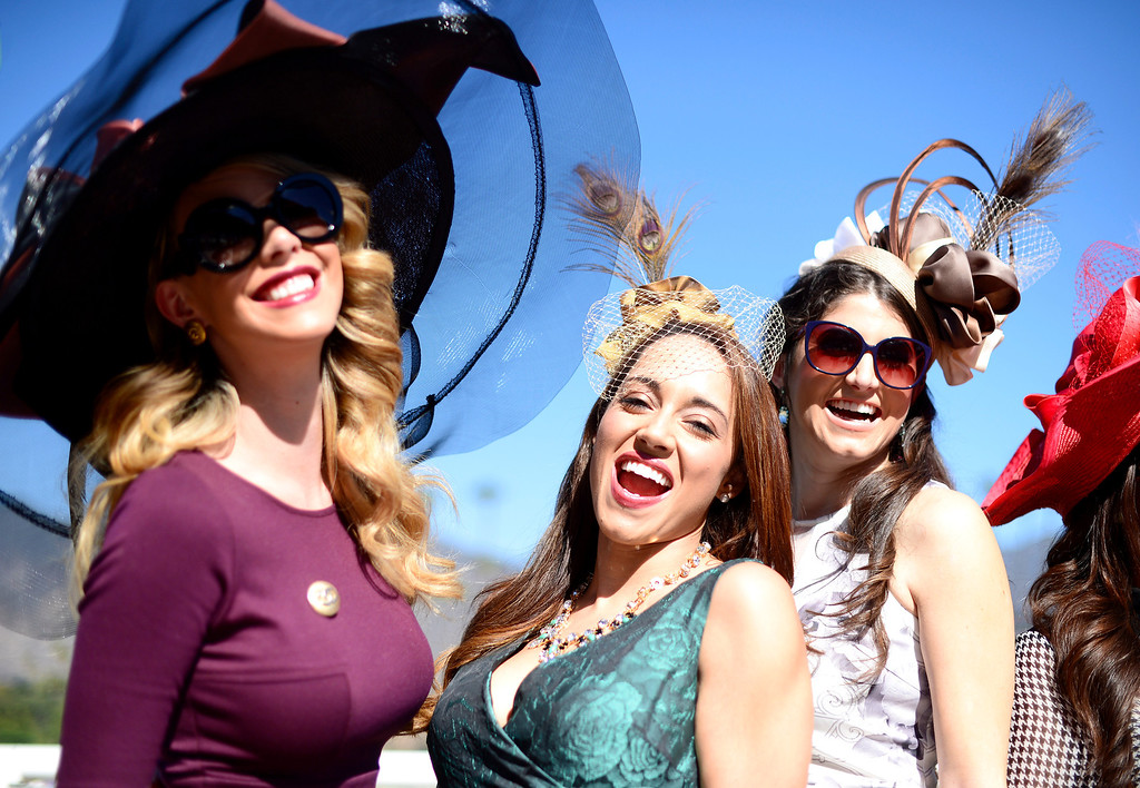 Description of . Fashion bloggers from left, Kier Mellour, Elizabeth Keene and Laura Yazdi gather during the Breeders' Cup at Santa Anita Park in Arcadia Friday, November 1, 2013. (Photo by Sarah Reingewirtz/Pasadena Star-News)