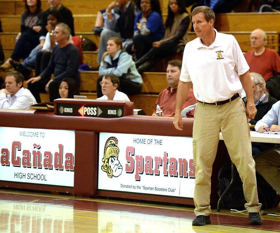 Description of . La Canada head coach Tom Hofman in the second half as he would win his 600th game as they defeated La Salle 73-62 during a prep basketball game at La Canada High School in La Canada, Calif., on Friday, Jan. 10, 2014. Hofman record is 600 wins and 186 losses since becoming varsity head coach in the 1986-87 season. (Keith Birmingham Pasadena Star-News)