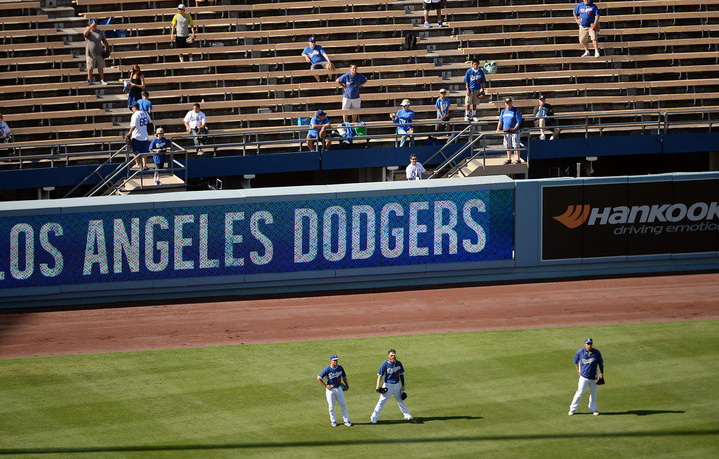 Description of . Los Angeles Dodgers shag fly baseballs in the outfield prior to a Major league baseball game between against the San Diego Padres on Saturday, July 12, 2014 in Los Angeles.   (Keith Birmingham/Pasadena Star-News)