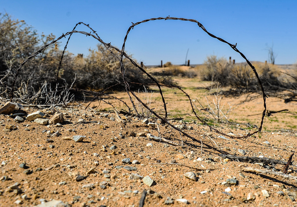Description of . Barbed wire lays on the ground near a plot of land in Hinkley, Calif. on Saturday, March 16, 2013. In the last two years, residents have become aware that a toxic water plume continues to grow below their small town, some have moved out of Hinkley. (Rachel Luna / San Bernardino Sun)