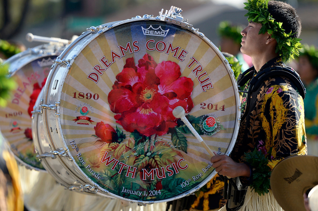 Description of . A base drummer from the Hawaii All State Marching Band is near the end of the parade route during the 2014 Rose Parade in Pasadena, CA January 1, 2014.(John McCoy/Los Angeles Daily News)