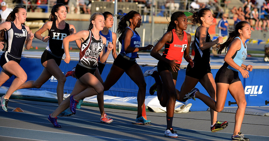 Description of . Redland's Claire Crowley, left, Claremont's Annie Boos (5) along with Etiwanda's Jacquelyn Hill (6), Crescenta Valley's Megan Melnyk and Baldwin Park's Susie Garza, center, competes in the 800 meter run during the CIF-SS Masters Track and Field meet at Falcon Field on the campus of Cerritos College in Norwalk, Calif., on Friday, May 30, 2014.   (Keith Birmingham/Pasadena Star-News)