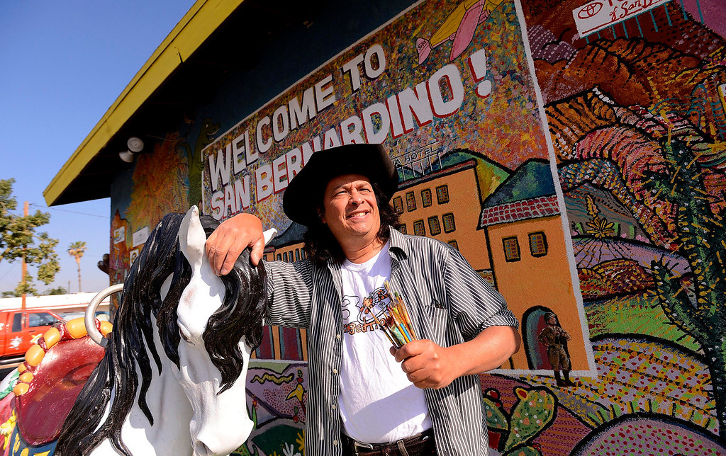 Description of . Artist Phil Ye, 58, of Running Springs, stands in front of a mural he's been painting on the side of the McDonald's Museum for over a year in San Bernardino May 9, 2013.  (Photo by Gabriel Luis Acosta/The Sun)