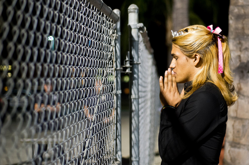 Description of . Patrick Cordova, 16, a transgender senior, prays while he awaits for his dad to accompany him in the homecoming halftime at Citrus College Stadium in Glendora on Friday night, Sept. 27, 2013. (Photo by Watchara Phomicinda/ San Gabriel Valley Tribune)