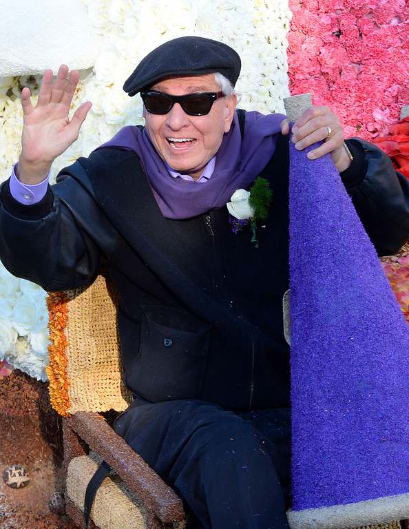Description of . Garry Marshall rides atop the City of Burbank float during the 2014 Rose Parade in Pasadena, CA January 1, 2014.(Keith Durflinger/San Gabriel Valley Tribune)