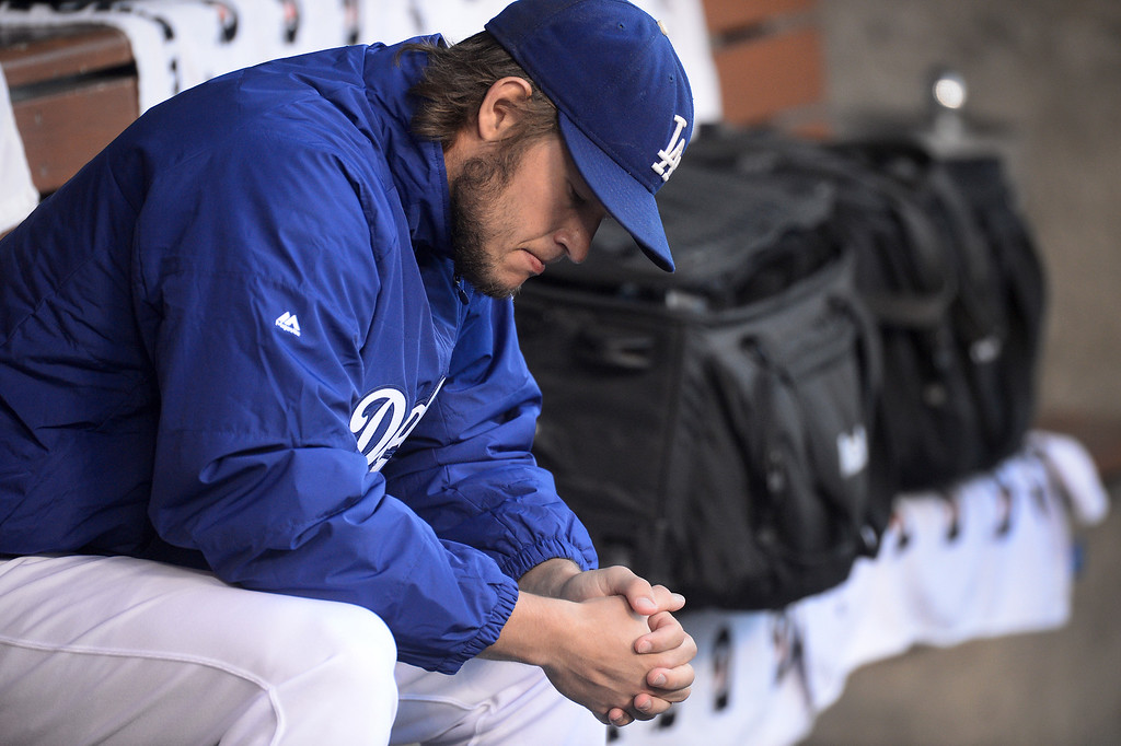 Description of . Los Angeles Dodgers' Clayton Kershaw sits in the dugout before they play the Atlanta Braves during game 4 of the NLDS at Dodger Stadium Monday, October 7, 2013. (Photo by Sarah Reingewirtz/Los Angeles Daily News)