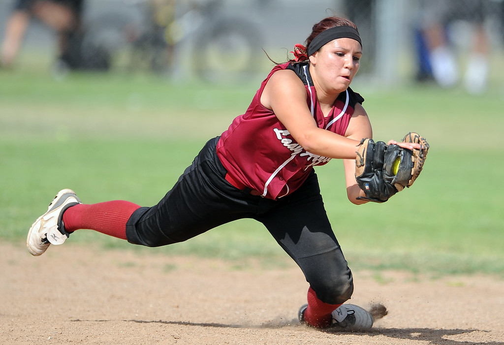 Description of . Barstow shortstop Aleesha Rodriguez dives for the catch on a line drive by Northview's Reyanne Gonzales (not pictured) in the fifth inning of a CIF-SS quarterfinal playoff softball game at Northview High School on Thursday, May 23, 2013 in Covina, Calif. Northview won 5-4.  (Keith Birmingham Pasadena Star-News)