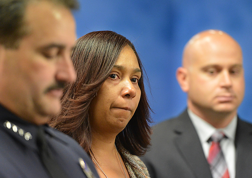 Description of . Tamara Decatur, mother of Kevon Decatur, is flanked by Mark Garcia, Redlands Chief of Police, left, and Detective Dominic Provero during a Wednesday May 21, 2014. Redlands Police are asking for the public's help finding who killed 22-year-old Kevon Decatur a Moreno Valley resident. Decatur was performing as a rap artist at Cancun Bar and Grill nightclub on Colton Avenue and Tri-City-Center Drive in Redlands Jan. 20, 2013. He was reportedly confronted by three subjects outside the nightclub. (Photo by Rick Sforza/Redlands Daily Facts)