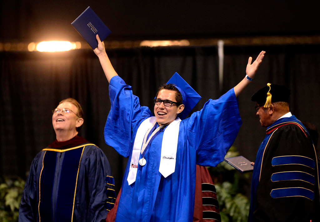 Description of . Christopher Martinez, 18, of San Bernardino, reacts as he receives his diploma during Rialto High School Commencement Exercises held at Citizens Bank Arena in Ontario June 2, 2013. GABRIEL LUIS ACOSTA/STAFF PHOTOGRAPHER.