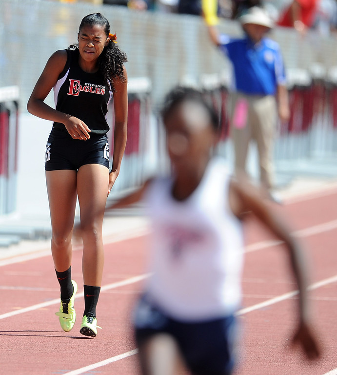 Description of . Etiwanda's Kayla Richardson pulls-up injured in the 100 meters race during the CIF-SS track & Field championship finals in Hilmer Stadium on the campus of Mt. San Antonio College on Saturday, May 18, 2013 in Walnut, Calif.  (Keith Birmingham Pasadena Star-News)