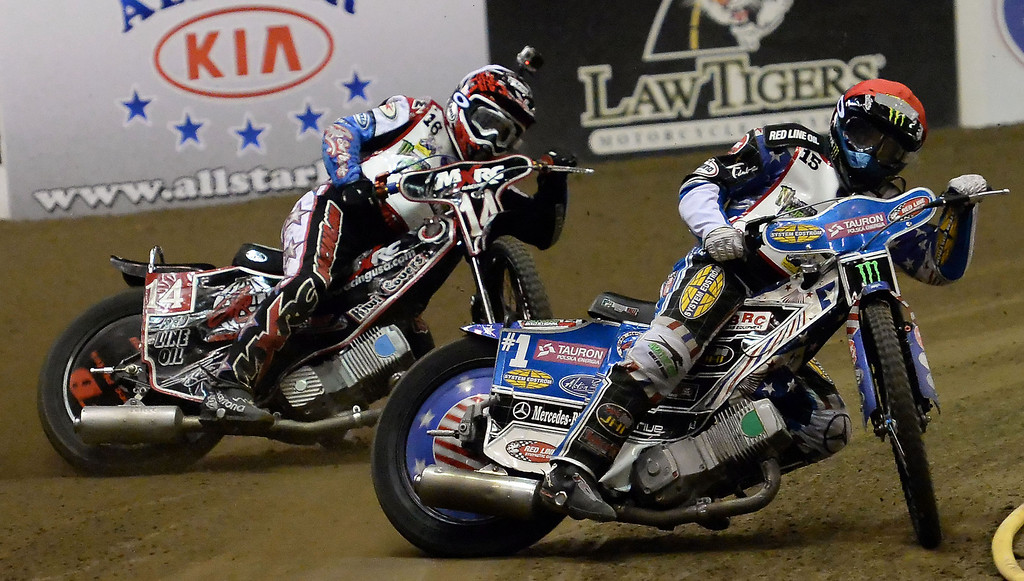 Description of . Greg Hancock (15) along with Billy Janniro (16) in the fourth race during the Monster Energy Speedway Cycles at the Industry Speedway in the Industry Hills Grand Arena in Industry, Calif., on Saturday, Dec. 28, 2013.     (Keith Birmingham Pasadena Star-News)