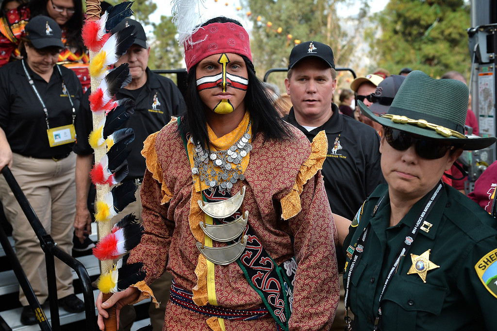 Description of . Florida State mascot Chief Osceola is escorted through an alumni party before the BCS game at the Rose Bowl, Monday, January 6, 2014. (Photo by Michael Owen Baker/L.A. Daily News)