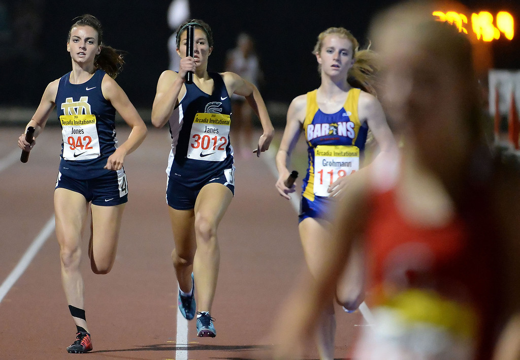 Description of . Saugus' Sabrina Janes, center, runs the final leg of the 4x1600 Meter Relay Invitational during the Arcadia Invitational track and field meet at Arcadia High School in Arcadia, Calif., on Friday, April 11, 2014. Great Oak won the race.  (Keith Birmingham Pasadena Star-News)