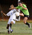 Quartz Hill #8 Alexa Adams and S. Torrance #27 Jessica Nakae tangle. The Girls from Quartz Hill defeated South Torrance in a sudden death overtime in a Southern Section Division IV Semifinal soccer game. Quartz Hills, CA 2/23/2013(John McCoy/Staff Photographer)