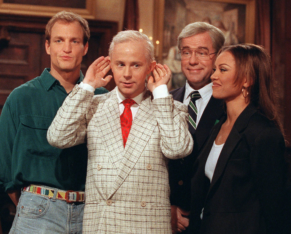 Description of . Actor Woody Harrelson, left, and entertainer Vanessa Williams, right, join Saturday Night Live regulars Dana Carvey, dressed as Johnny Carson, center, and Phil Hartman, dressed as Ed McMahon, for a taping of Saturday Night Live in this May 15, 1992 photo. (AP Photo/Alex Brandon)