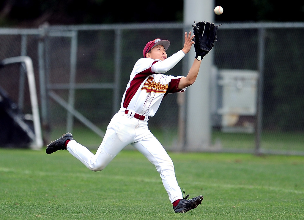 Description of . La Canada's Cole Herzer catches a fly ball by San Marino's Matt Wofford (not pictured) in the seventh inning of a prep baseball game at La Canada High School on Wednesday, March 8, 2013 in La Canada, Calif. La Canada won 3-2.  (Keith Birmingham Pasadena Star-News)