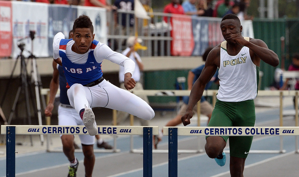 Description of . Los Alamitos' Tyler Rios wins the division 1 300 meter Intermediate hurdles during the CIF Southern Section track and final Championships at Cerritos College in Norwalk, Calif., Saturday, May 24, 2014. 