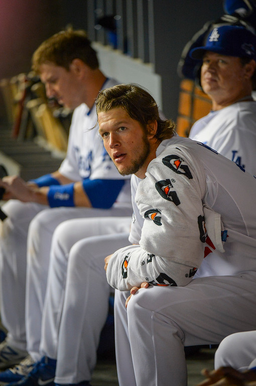 Description of . Dodger's Clayton Kershaw rests during game action Monday, October 7, 2013 ( Photo by Andy Holzman/Los Angeles Daily News )