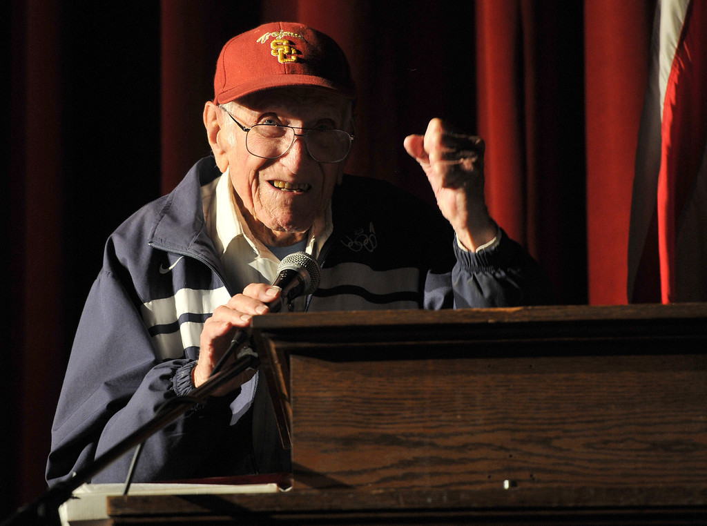 Description of . Torrance---3/31/11---Daily Breeze Photo:  Robert Casillas ---  Torrance legend Louis Zamperini paid a visit to his alma mater Torrance High to visit with alumni and meet students. Zamperini pumps his fist to acknowledge cheers from students.