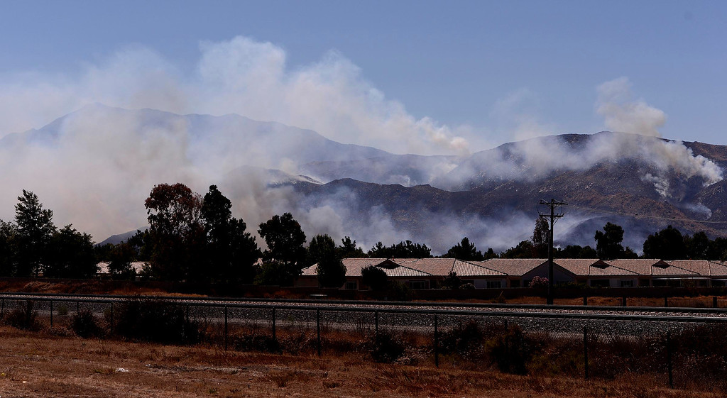 Description of . A view of the Silver Fire as seen from W. Lincoln Street as  it burns in the mountains south of Banning August 8, 2013.   GABRIEL LUIS ACOSTA/STAFF PHOTOGRAPHER.